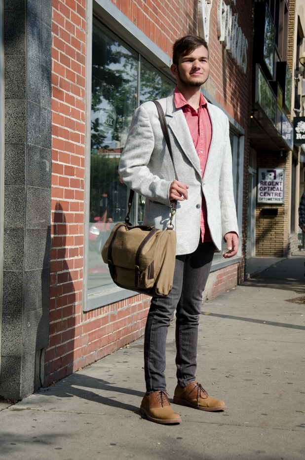 University of Alberta student wears brown on tan contrast saddle shoes with a cream tweed blazer and a pink shirt.