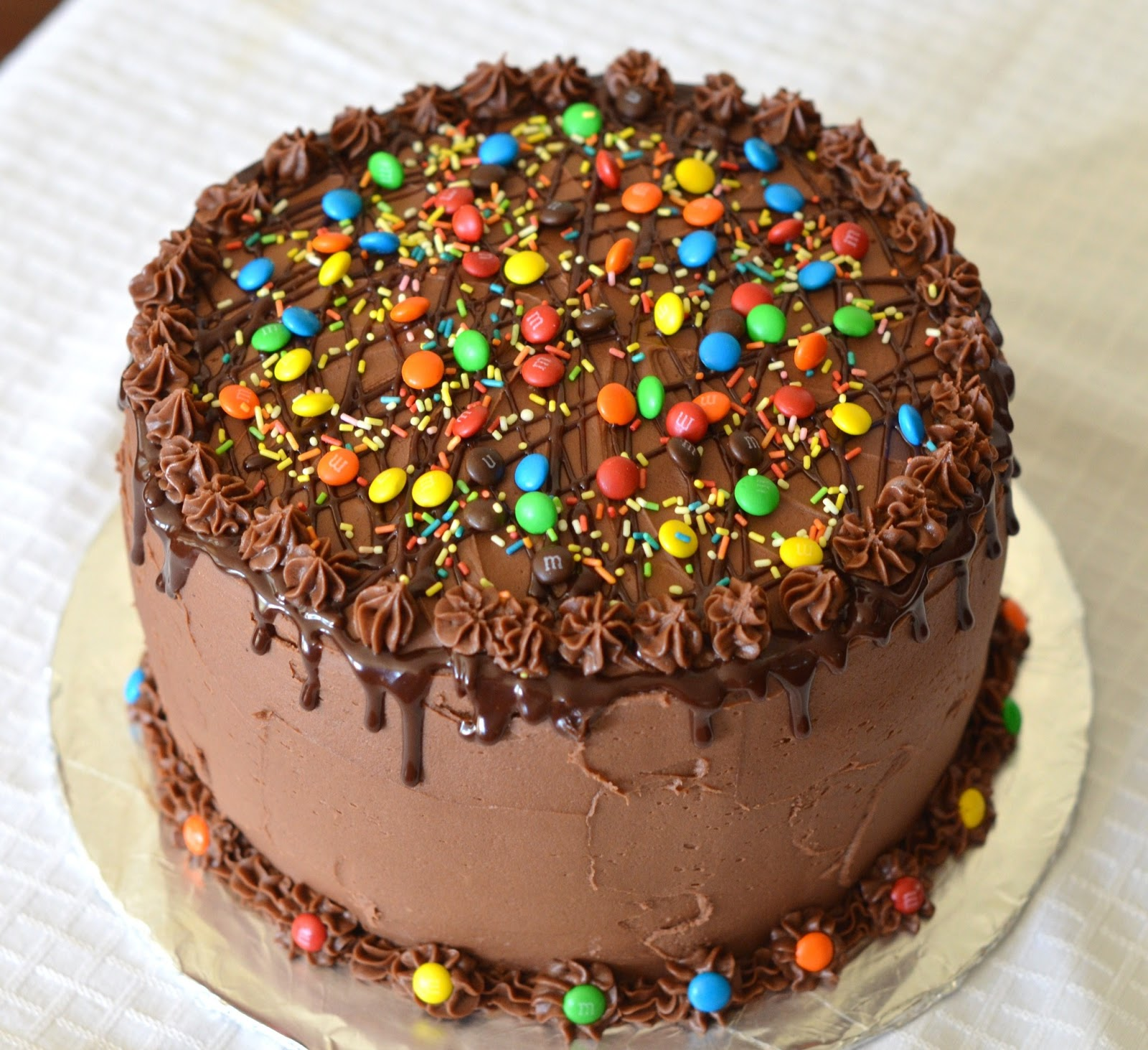 Smooth Cream and Pink Cake with Chocolate Drip and