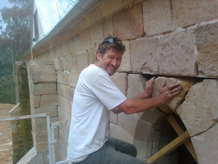 Thats me putting in the last of the window stones Karl is having a beer