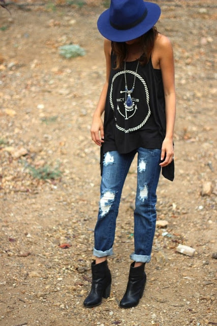 boyfriend jeans combination A rock chic top, black ankle boots and a cool hat