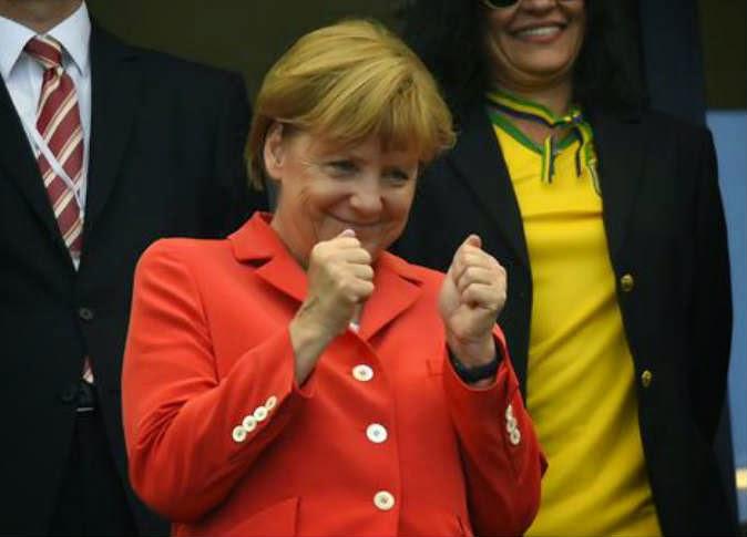 ماذا فعلت أنجيلا ميركيل داخل حجرة ملابس اللاعبين و بعد فوز المانيا بكاس العالم