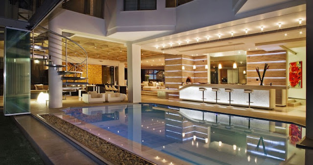 Photo of pool house with private bar at night