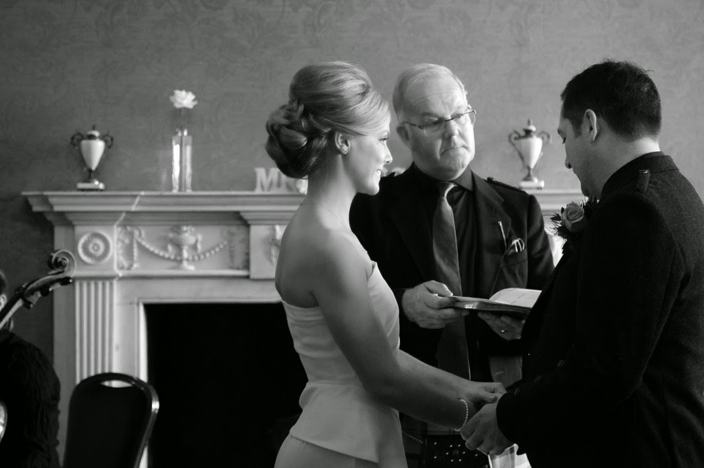 the braid in the brides hair can be seen as she makes her vows