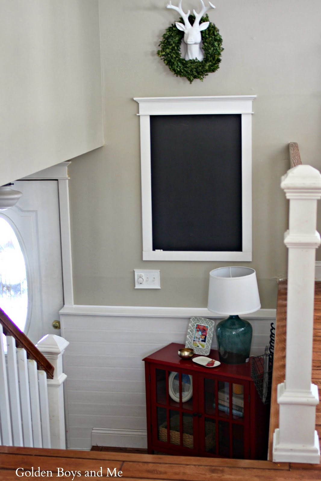 entryway chalkboard with deer head and boxwood with Target Threshold cabinet-www.goldenboysandme.com