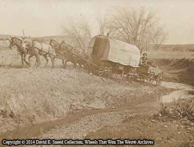 this sheep camp wagon has a peter schuttler supply wagon in tow as it crosses a low narrow portion of the powder river - Sheep Wagon 2