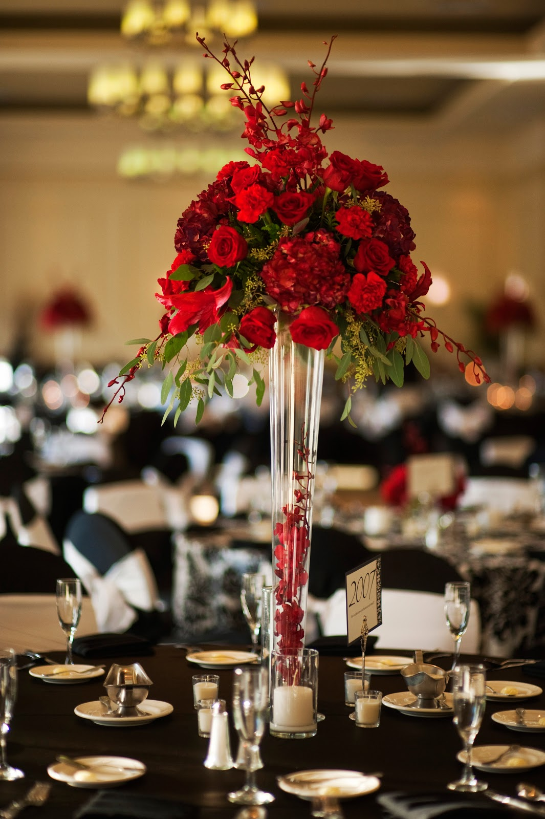Tall red centerpiece sheraton tampa centerpieces