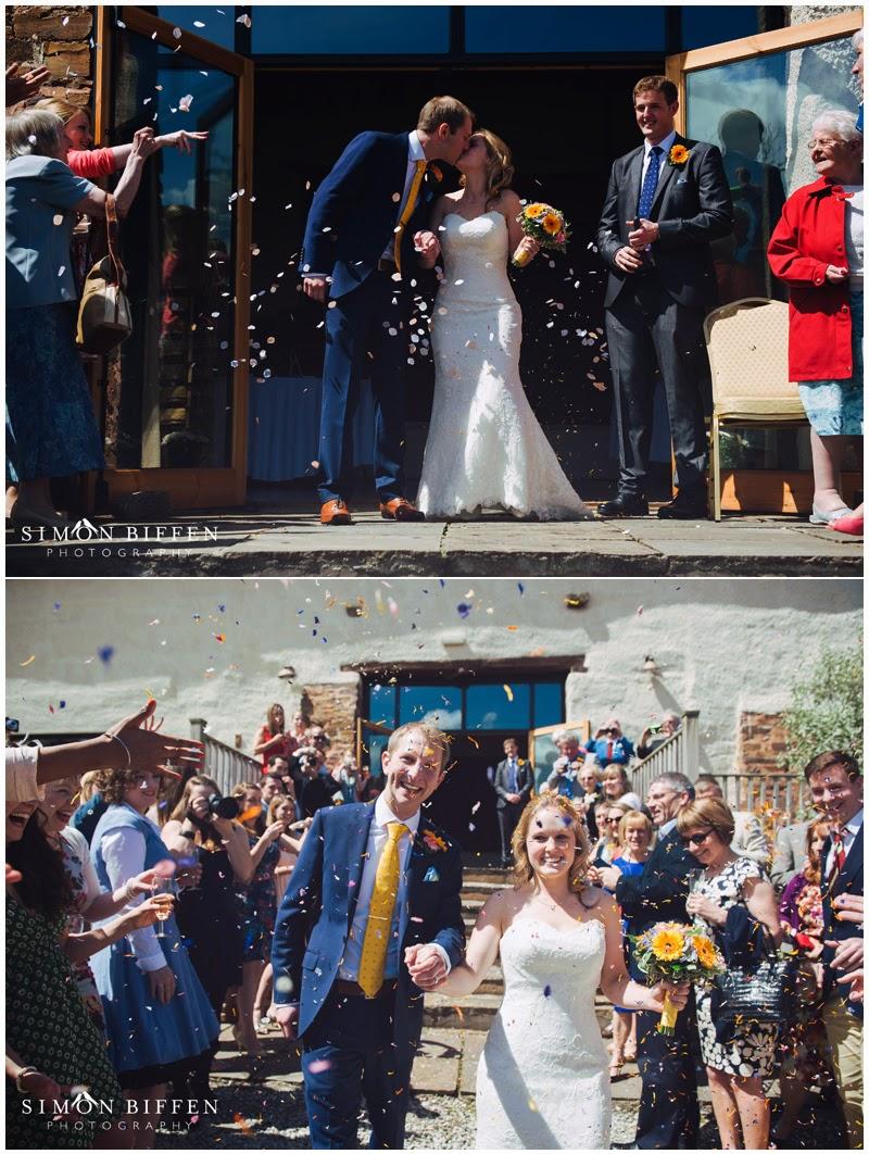 Confetti at wedding ceremony at the Corn Barn Devon