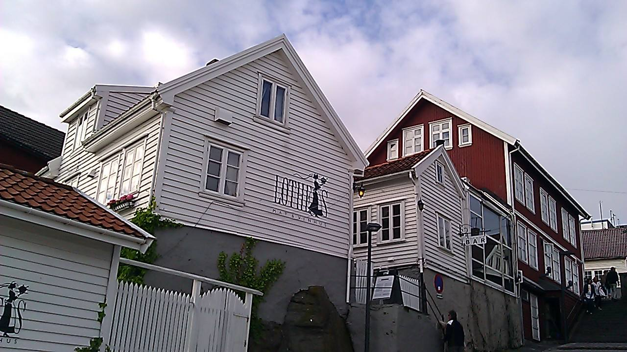 Note the similarities in the clapboard-style architecture in 'The Vincarage' image and this photo of the Lothes Mat & Vinhus in Haugesund, Norway. Photo: EuroTravelogue™. Unauthorized use is prohibited.
