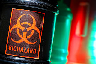 Biohazardous material in laboratory bottles.