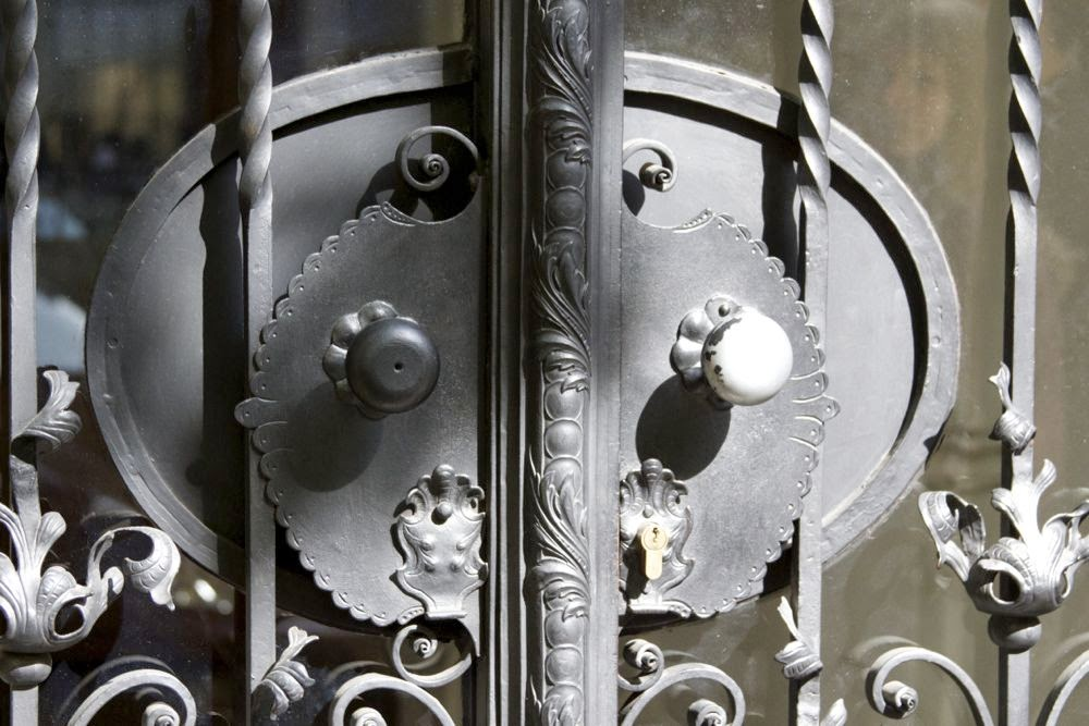 glass door with iron ornaments