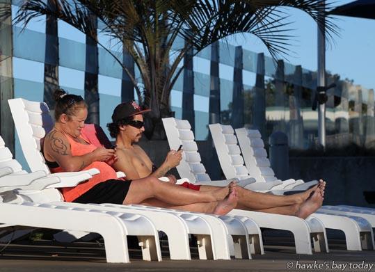 L-R: Delma Kingi, Napier, Kahn Povey, Napier, enjoying the sun, sunbathing on a warm winter's day at Ocean Spa, Napier photograph