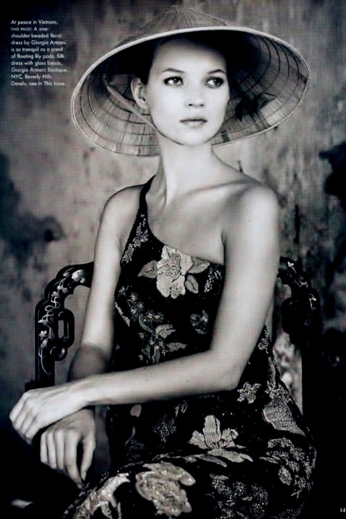 Kate Moss wearing Vietnamese hat, 1996