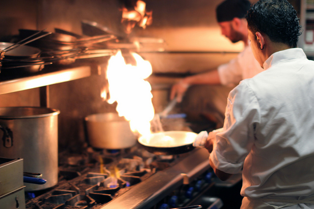 Two chefs working hard in a kitchen