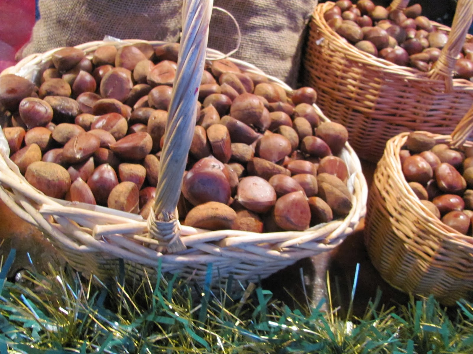 Chestnuts in baskets in a chestnut cart