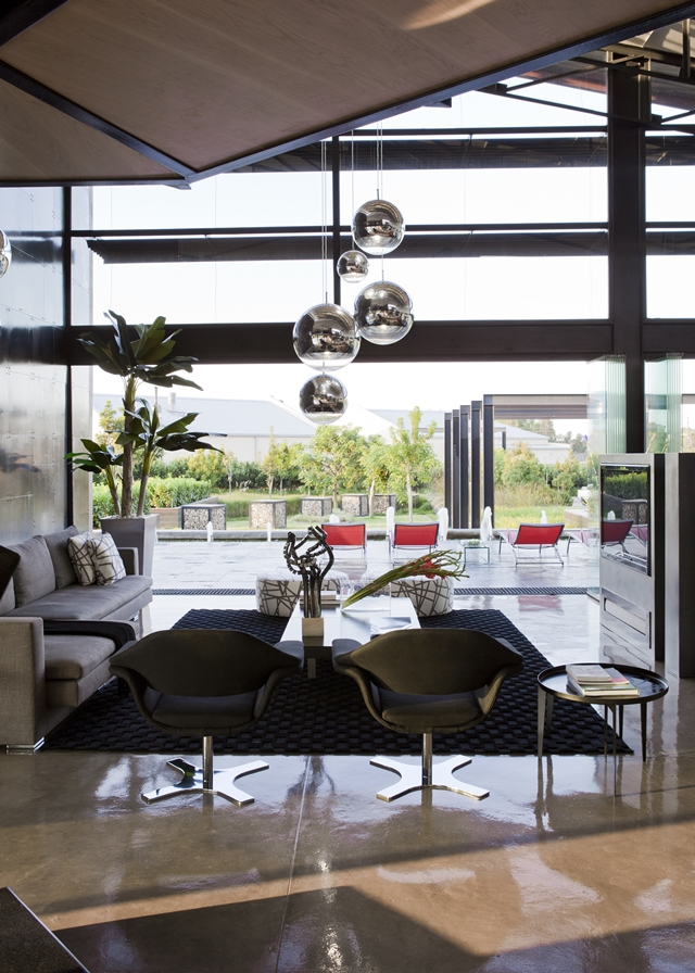 Modern living room with glass wall