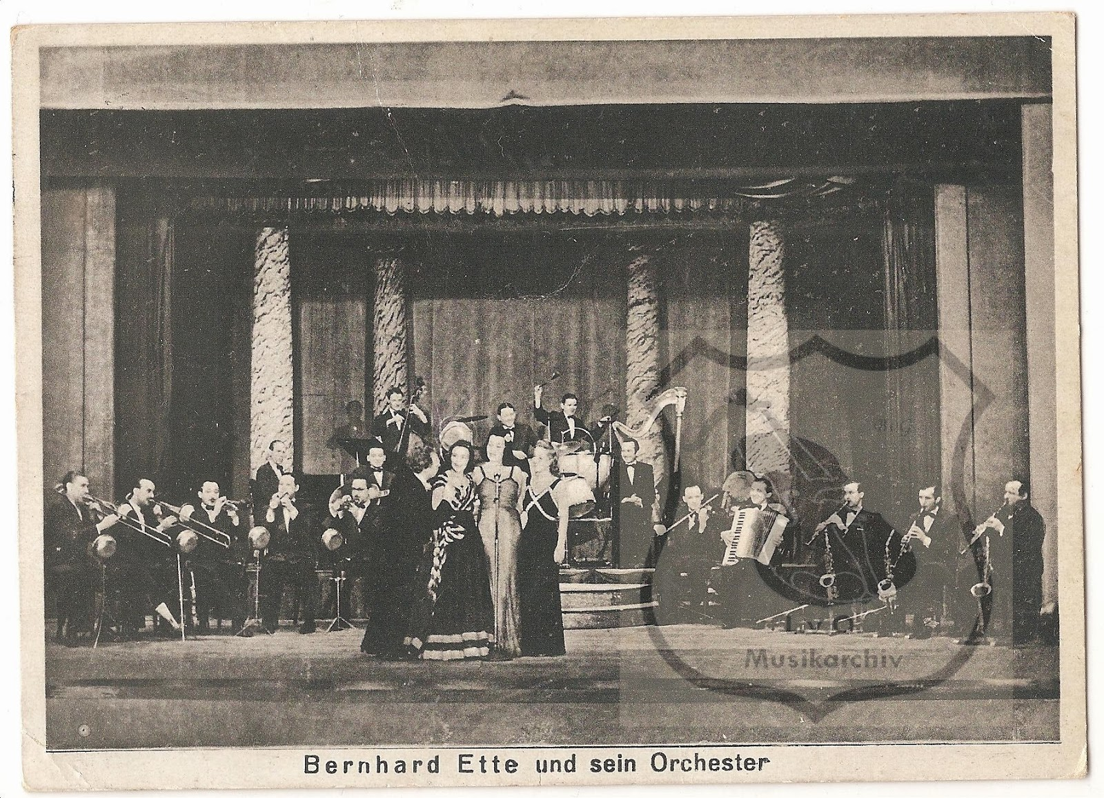 Photograph of Bernhard Ette and his Orchestra - possibly taken in  the studios in Berlin-Schöneberg. Photograph from the Grammophon-Platten website  which suggests that the three ladies in the foreground are (left to right):  Claire Bauerle, Gisela Katt, Madeleine Lohse