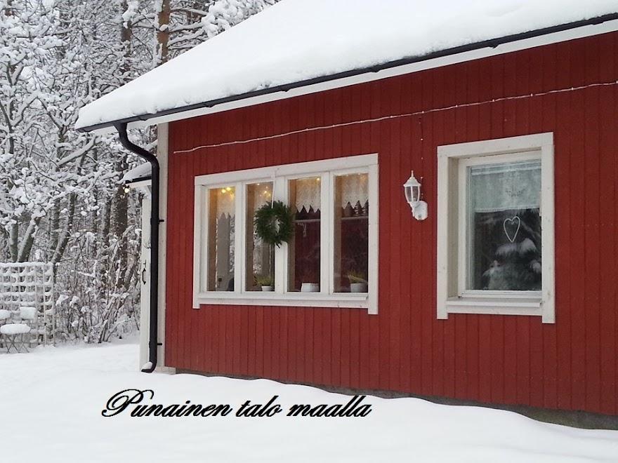 Punainen talo maalla