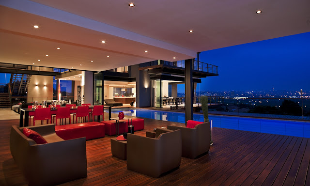 Picture of brown outdoor furniture on the covered terrace by the pool