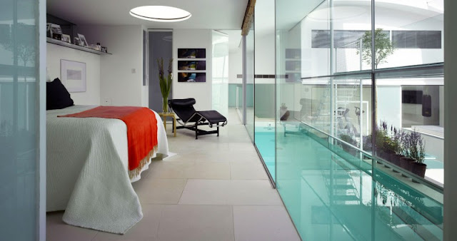 Blue Pool View near the Home Bedroom with Wide Bed and Black Lounge Chair