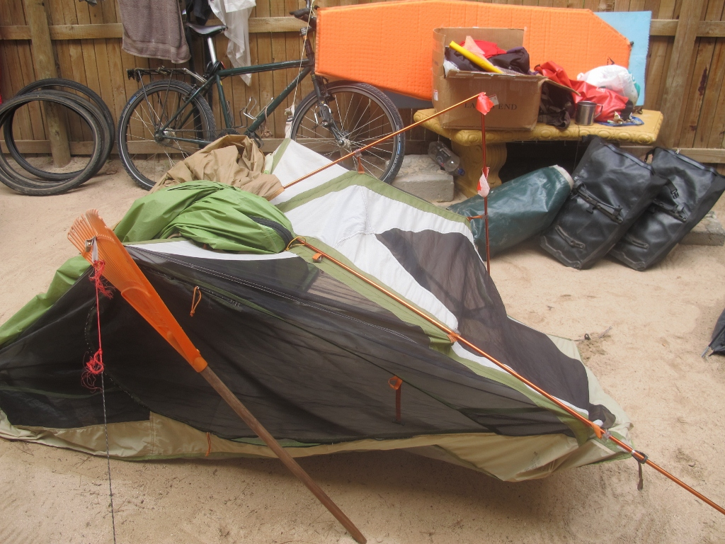However the broken rake that I propped under one of two sewn up zipper doors in order to combat last nights rain is just too much of a site for my sarcasm. & Solo Female Cycling Around the World: Rags To Riches...Whatu0027s The ...