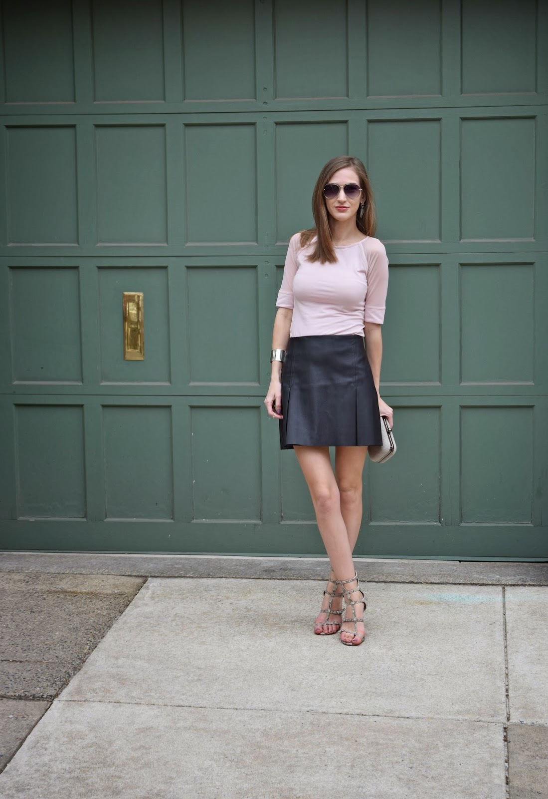 wearing Express faux leather pleated mini skirt, Express mesh sleeve pink top., BCBG gladiator heels
