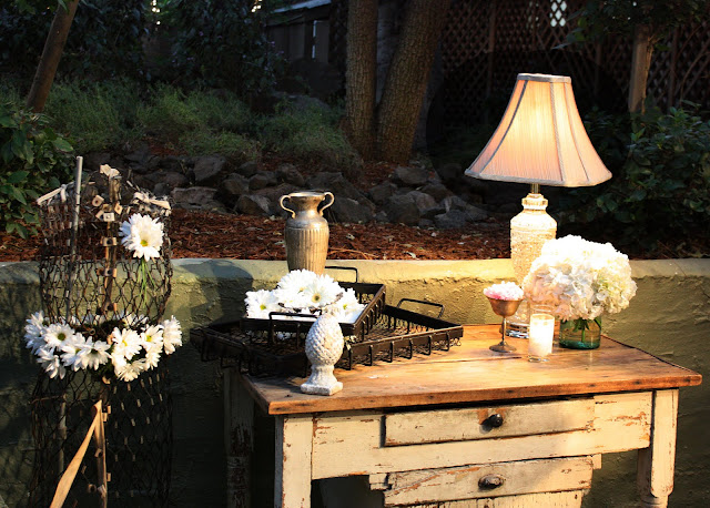 LOVED all of the different vignettes created with the vintage furniture
