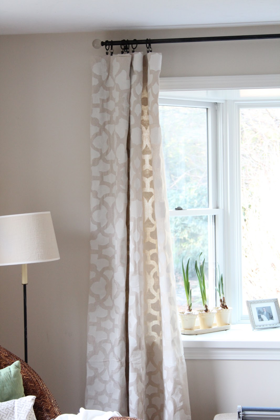 We used simple curtain clips to attach the drop cloths - Stenciled Drop Cloth Curtains