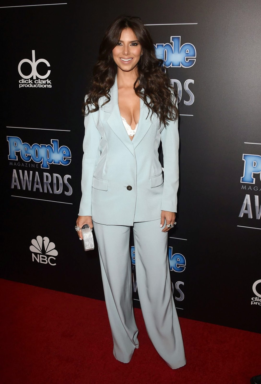 Roselyn Sanchez Reveals Lace Bra In A Pant Suit At The