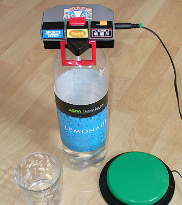 Switch adapted accessible drinks dispenser, set-up here to dispense Lemonade.