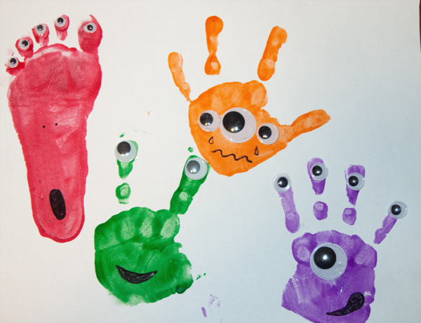 we made some crazy eyed hand and foot print monsters i was inspired