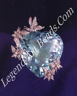 Platinum and diamond butterflies on a large heart shaped 61-carat aquamarine brooch, 1969.