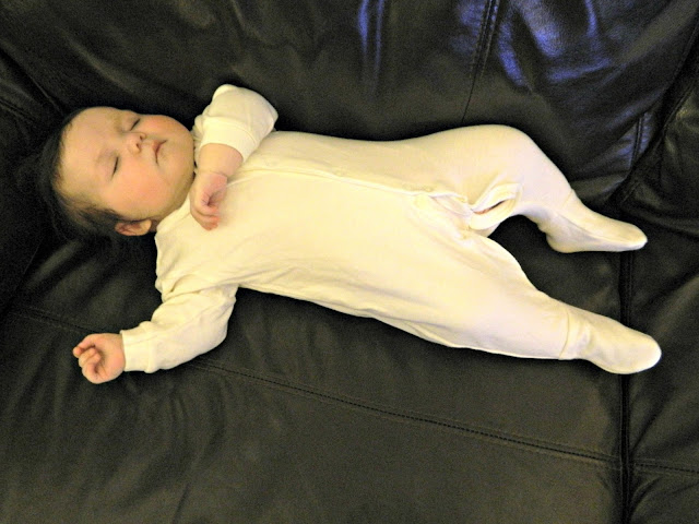 Baby girl asleep sleeping white sleepsuit onesie