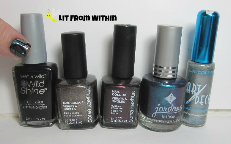 Bottle shot:  Wet 'n Wild Black Creme, Sonia Kashuk Dime a Dozen and Russian Roulette, Jordana De'ja' Vu Blue, and a silver nail art striper.