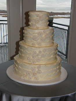 4-tier round buttercream with fondant flowers