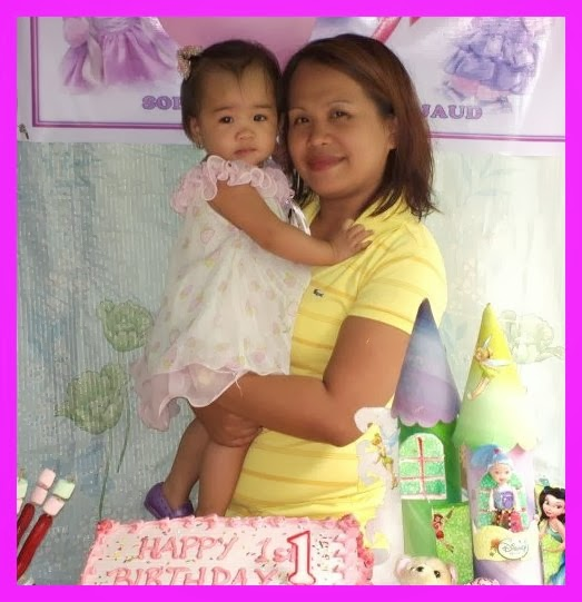 Inday Sophie is carried by her mother posing for posterity