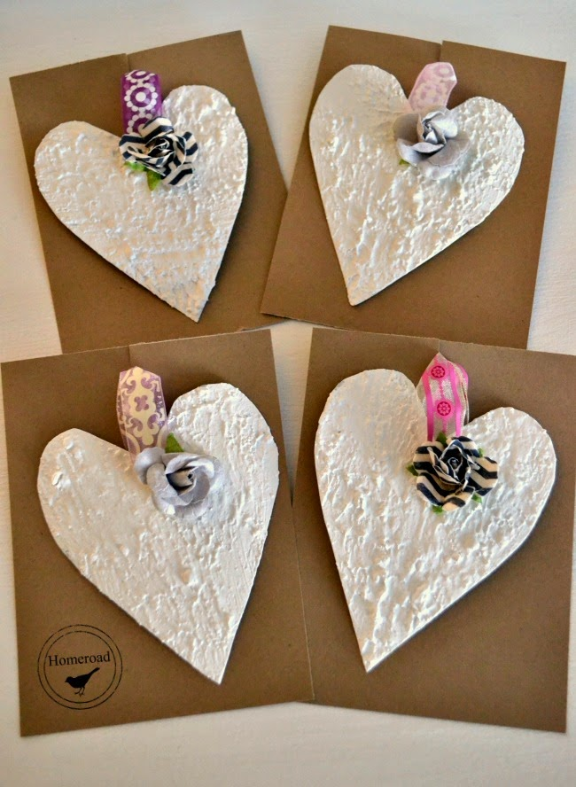 Textured paint tin hearts for Valentine's Day www.homeroad.net