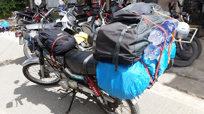 A motorcycle loaded with two backpacks for a ride from Dalat to NHA Trang, Vietnam.