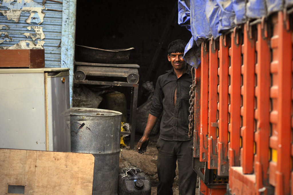 Man working in a garage in Dharavi.
