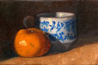 Oil painting of a mandarine beside a willow-pattern teacup.