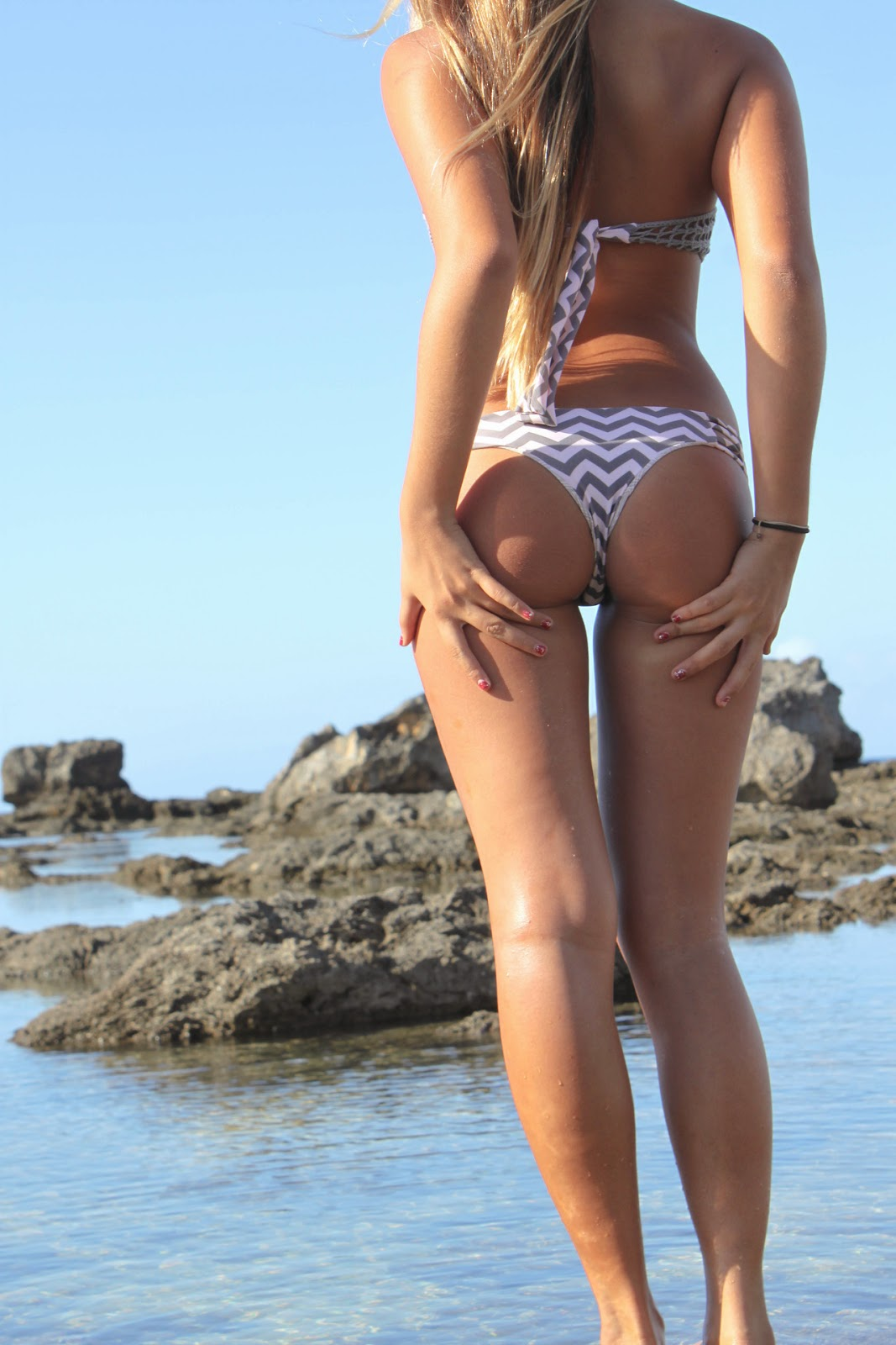 "swimsuit girl ass butt behind Hottest Trend You've Never Heard of... ""The Butt Grab"" Pose"