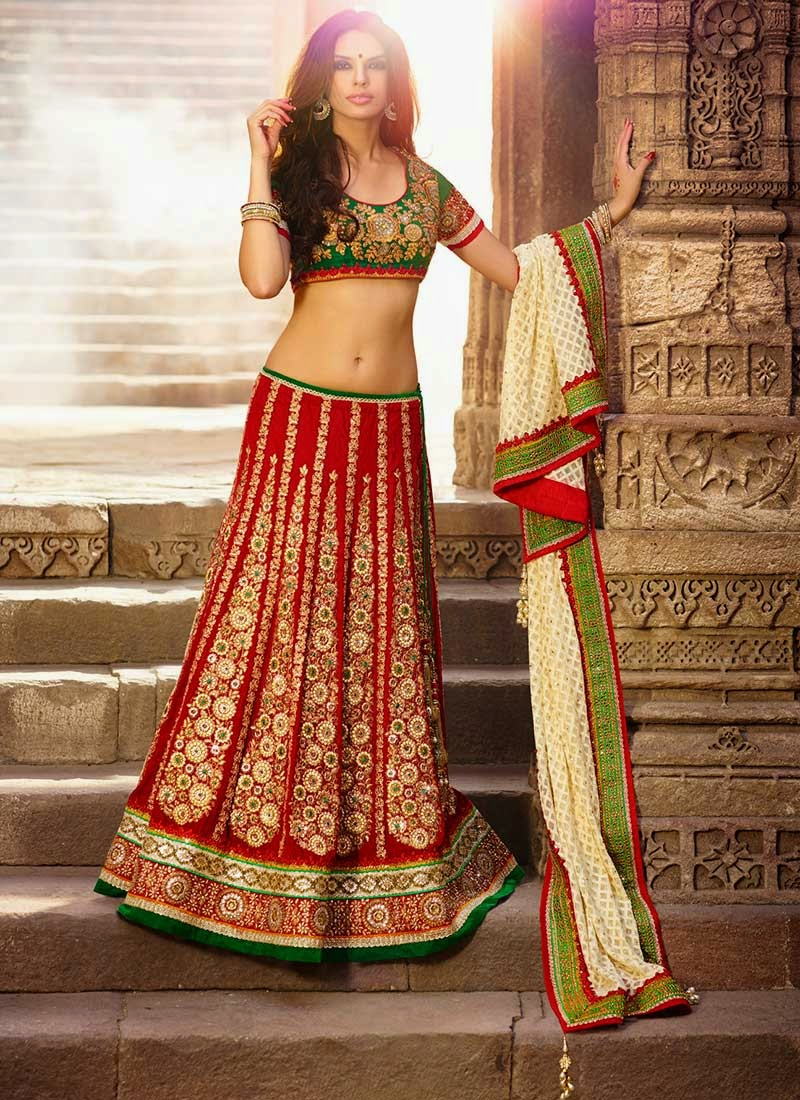 Buy Red Embroidered Velvet Lehenga Choli online from the wide collection of Lehenga. This Red  colored Lehenga in Velvet  fabric goes well with any occasion. Shop online Designer Lehenga from India at the lowest price.