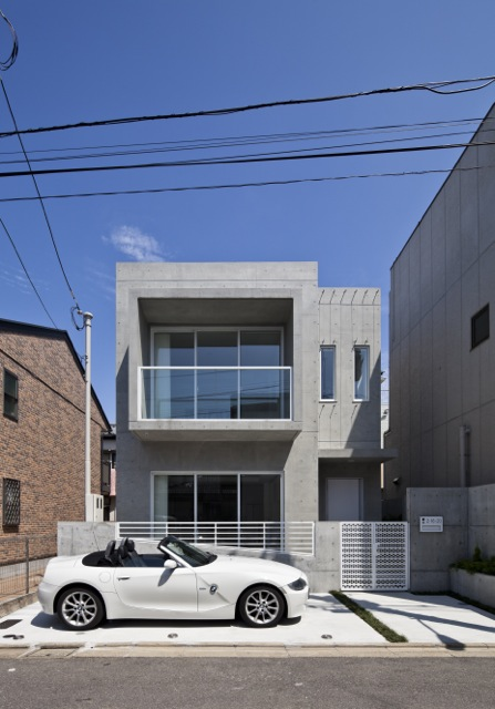 Photo of small modern minimalist home as seen from the street