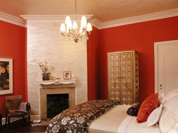 the bold wall color enhances the room making the fireplace the main