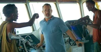 CAPTAIN PHILLIPS starring Tom Hanks (center) and Barkhad Abdi (left)