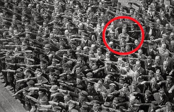 24 Rare Historical Photos That Will Leave You Speechless - A lone man refusing to do the Nazi Salut, 1936.