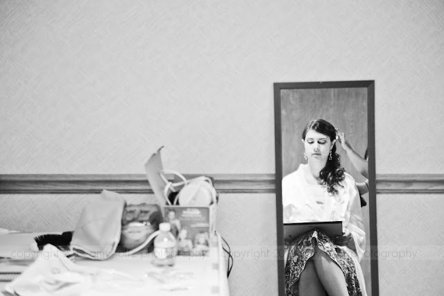 Reflection of bride preparing for wedding