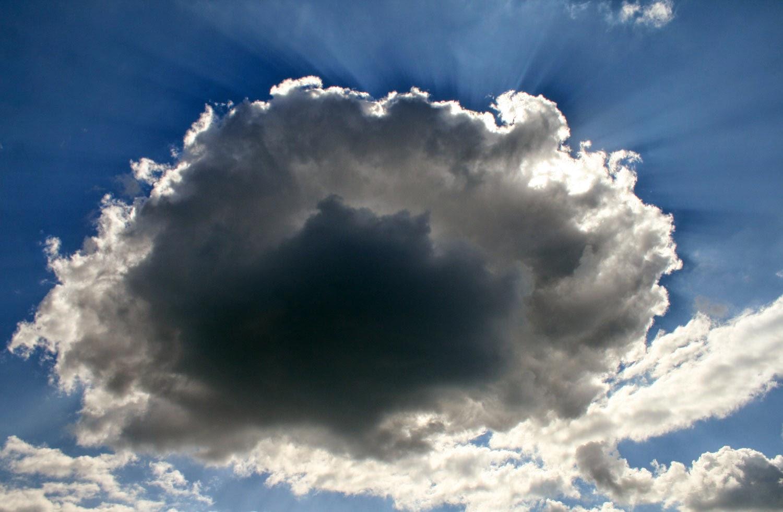 The sun behind a cloud