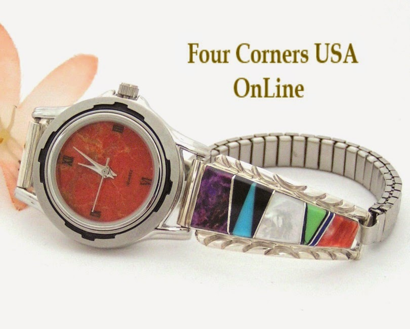 http://stores.fourcornersusaonline.com/womens-multi-color-inlay-sterling-watch-shown-with-apple-coral-face-navajo-arnold-yazzie-native-american-jewelry-naw-1426/