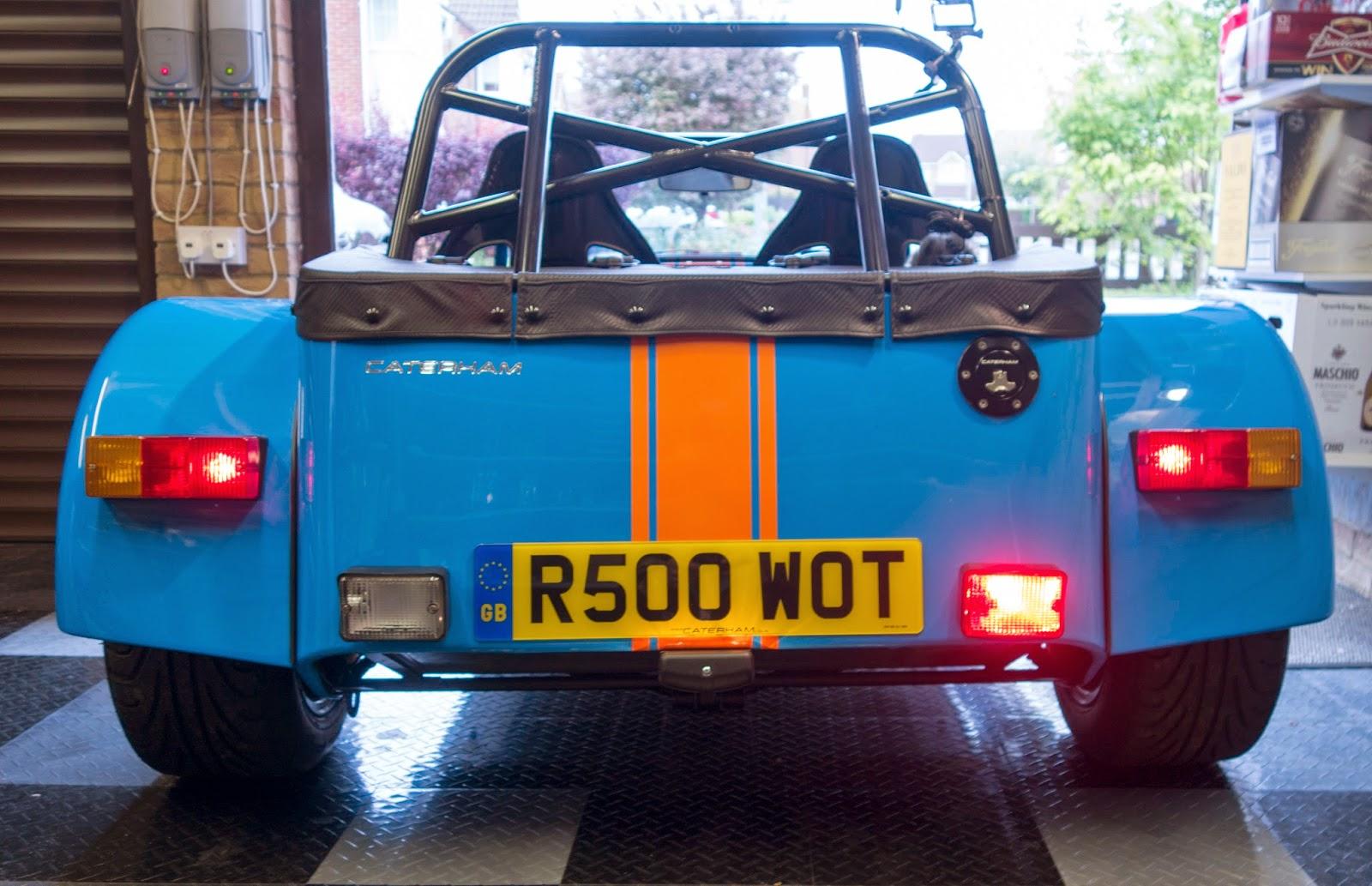 Standard rear lights including fog light illuminated.