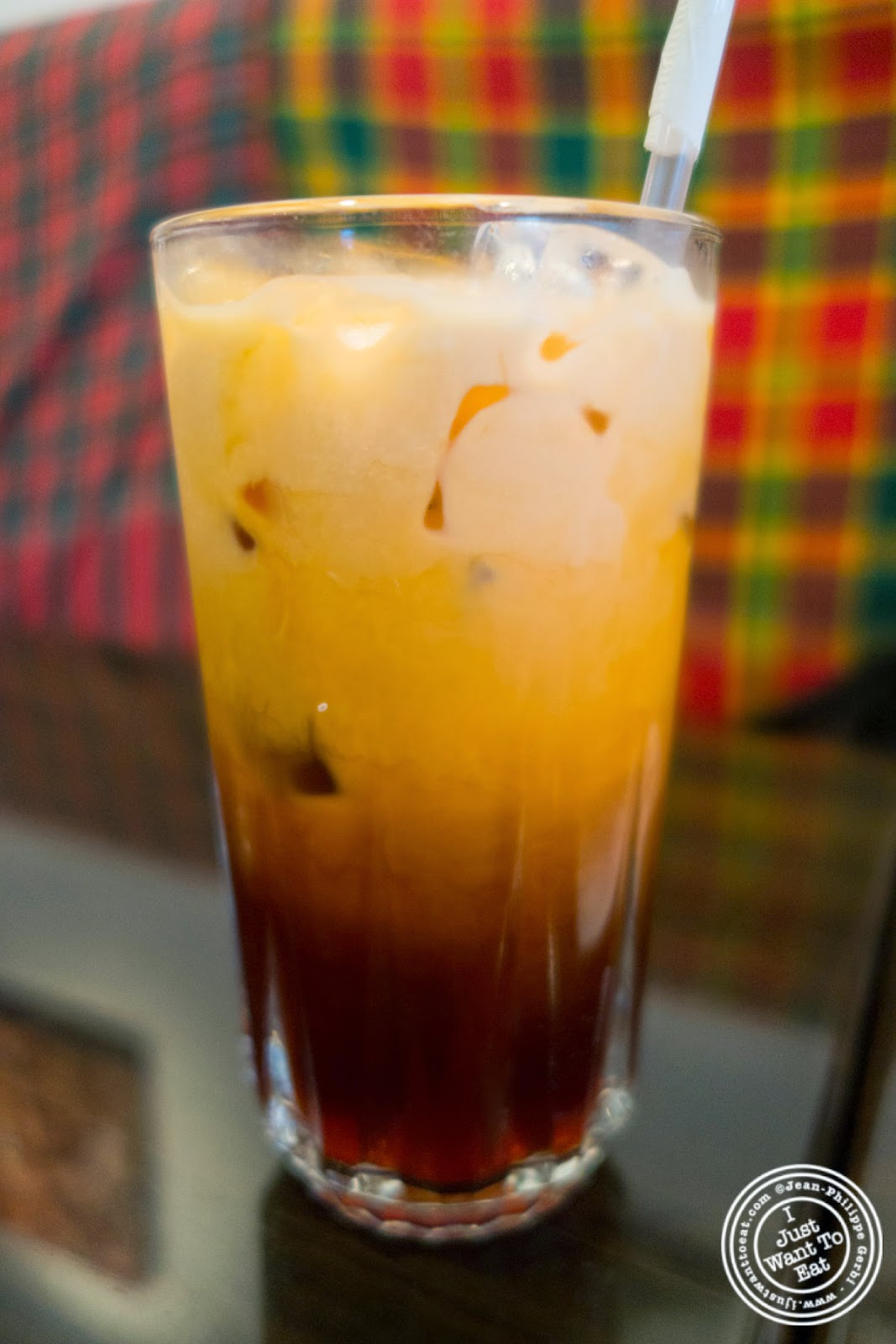 image of Thai iced tea at Larb Ubol, Thai restaurant in Hell's Kitchen, NYC, New York
